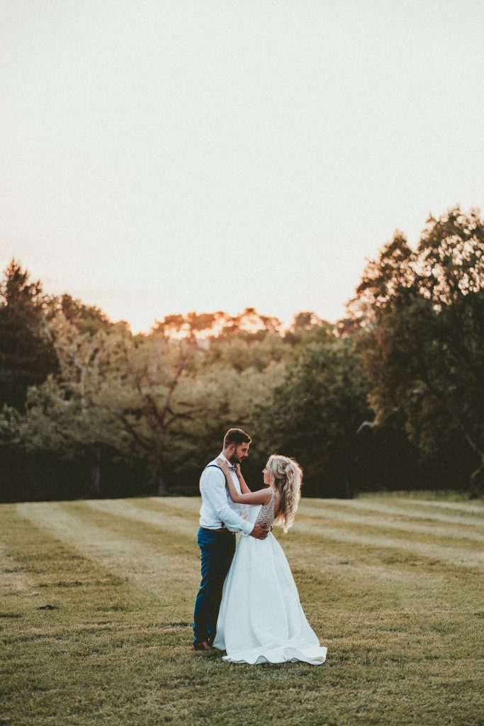 wedding couple, bride and groom on beautiful sunset