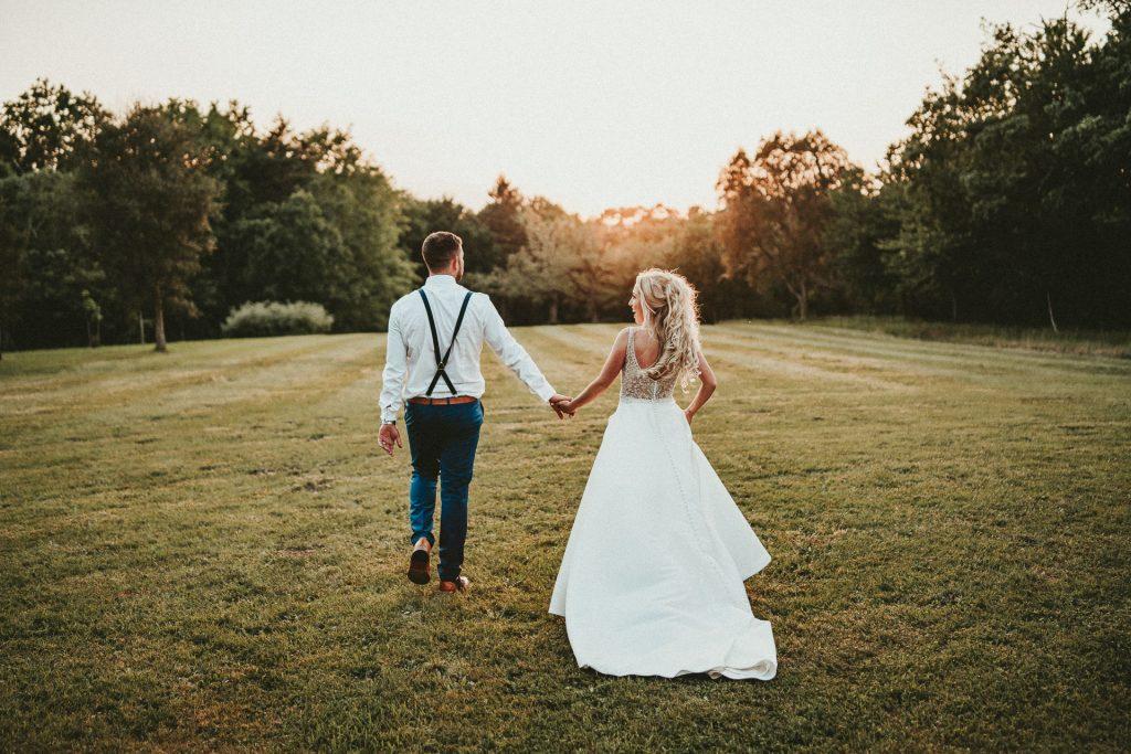 wedding couple, bride and groom on beautiful sunset